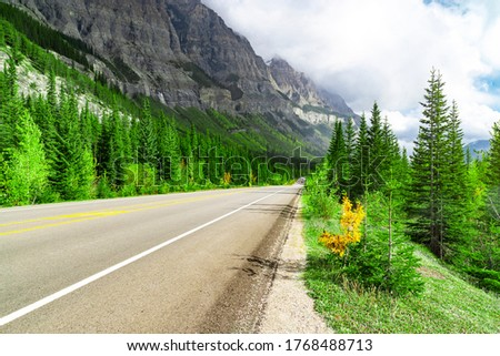 Cars Along Highway In Mountain Landscape In Alberta Canada Destination #1768488713