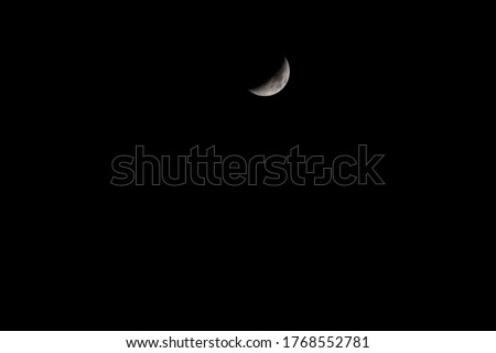 Half moon on the dark sky Capture my DSLR Camera.Real Picture of Moon.the Moon without cloud at night.Serenity nature background,outdoor at gloaming.beautiful nature landscape fantasy.Peaceful sky.