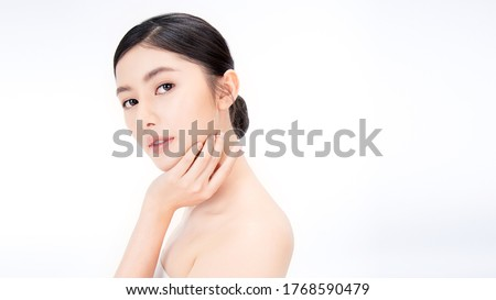 Closeup portrait of beauty asian woman with fair perfect healthy glow skin hand touching shoulder copy space, young beautiful asia girl with pretty smile on face. Beauty korean spa skincare banner