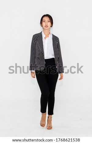 Asian woman full body portrait on white background wearing formal business suit . Royalty-Free Stock Photo #1768621538