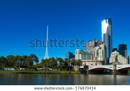 Melbourne skyline with skyscrapers and famous  Melbourne Arts Centre Spire seen across the river Yarra. Victoria, Australia #176870414