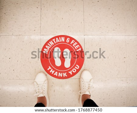 Maintain Social Distancing and Keep Your Distance 6 ft Please wait here for customer  at shop, restaurant, building, hotel, shopping mall, store. Concept Keep distance in public to protect COVID-19, c