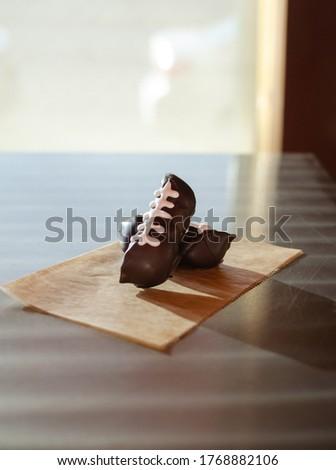 chocolate covered mini cannoli football pattern dessert. chocolate covered pastry delicious. #1768882106
