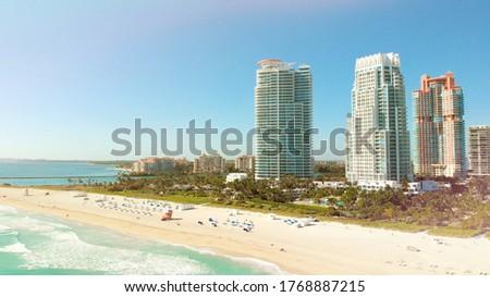 Miami Beach on a bright sunny day, aerial view. Drone flying forward near Miami Beach, South Beach, Florida. Aerial Photo of a luxury resort in Miami South Beach. Holidays in Miami Touristic City. #1768887215