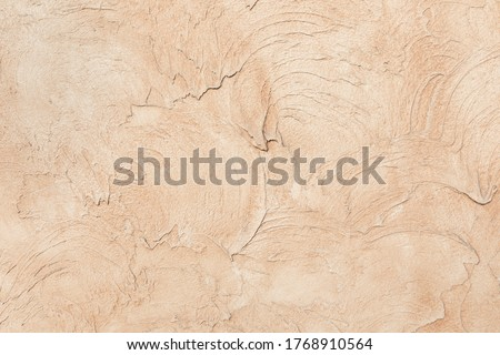 Beige low contrast smooth decorative plaster concrete textured background. Abstract soft neutral antique artistic backdrop texture to your concept or product Royalty-Free Stock Photo #1768910564