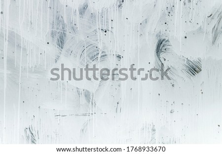 White paint on a window glass
