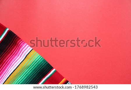 poncho Mexican cinco de mayo rug serape fiesta traditional Mexico background with stripes copy space maya blanket minimal simple -  stock, photo, photograph, image, picture  #1768982543