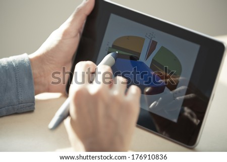Human hands using tablet PC and sylus for diagram working. Diagram was created by me #176910836