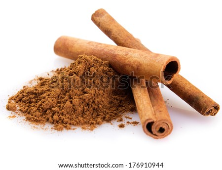 cinnamon sticks with powder isolated on white background #176910944