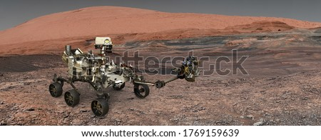Mars. The Perseverance rover deploys its equipment against the backdrop of a true Martian landscape. Exploring Mission To Mars. Colony on Mars. Elements of this video furnished by NASA. Royalty-Free Stock Photo #1769159639