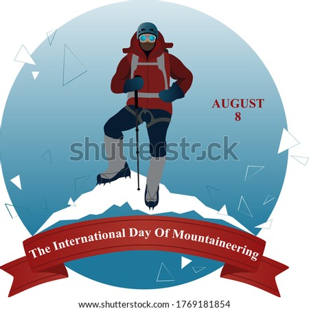 The international day of mountaineering. Climber stands on peak of the mountain.