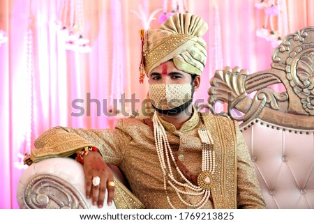 Indian bridegroom in mask.Protection against covid-19 pandemic during marriage ceremony. Safe wedding. Mask a new essential in post covid-19 marriages.  #1769213825