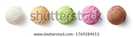 Set of five various ice cream scoops or balls isolated on white background. Top view. Vanilla, strawberry, caramel, pistachio and chocolate flavor Royalty-Free Stock Photo #1769284613