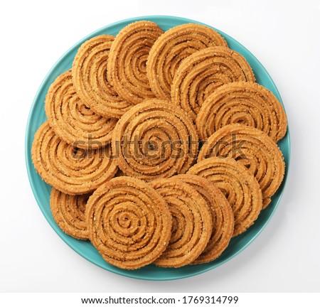 Traditional Indian Diwali snacks Chakali,murukku, Indian Traditional Tea Time Snack Chakli, a deep fried snack, It is known as Chakali, Murukku, Muruku, Murkoo, Chakri #1769314799