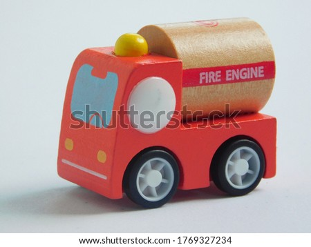 Close up view of fire engine on a white background