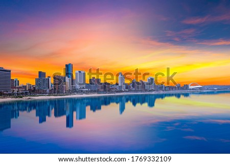 Durban city beachfront skyline during summer with twilight sky in Kwazulu-Natal SouthAfrica Royalty-Free Stock Photo #1769332109