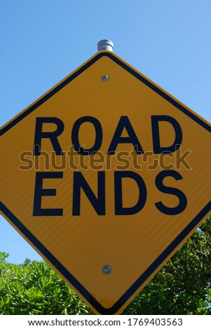 Yellow road sign with the words Road Ends, Magnetic Island Queensland, Australia