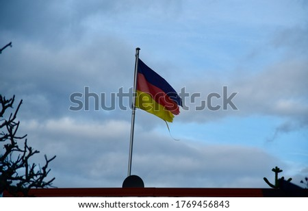 German flags with blue sky background unique photo