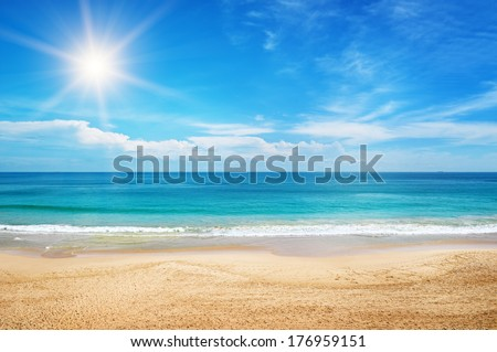 seascape and sun on blue sky background Royalty-Free Stock Photo #176959151