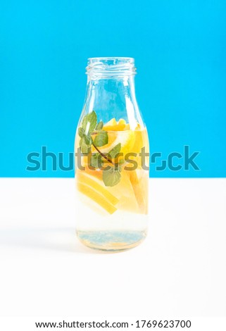 Glass container filled with slices of orange and water Photo #1769623700