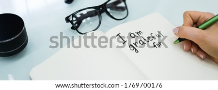 Gratitude Journal Concept. Writing I Am Grateful In Journal Royalty-Free Stock Photo #1769700176