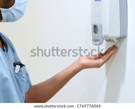 Hands under an automatic hand sanitizer machine/soap dispenser. infection control concept. Hand hygiene has very essential role in prevention of infective diseases. Royalty-Free Stock Photo #1769776064