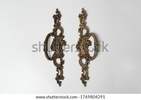 two furniture antique handles, bronze furniture handles on a white background, handles for vintage furniture, knobs from antique furniture #1769804291