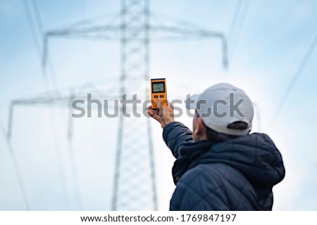 Electromagnetic radiation measuring under high voltage power transmission towers #1769847197