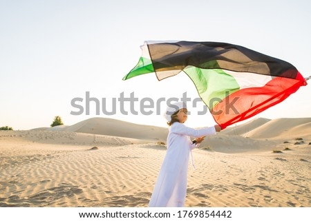 Arabian family with kids having fun in the desert - Parents and children celebrating holiday in the Dubai desrt Royalty-Free Stock Photo #1769854442