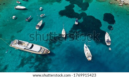Aerial drone photo of yacht anchored in popular bay and beach of Super Paradise, Mykonos island, Cyclades, Greece Royalty-Free Stock Photo #1769915423