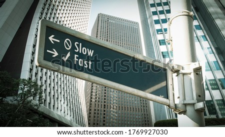 Street Sign the Direction Way to Fast versus Slow Royalty-Free Stock Photo #1769927030