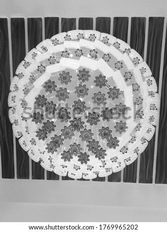 Floral Chandelier - Black And White Image of a flowery chandelier on a wooden backdrop, home decor collection.