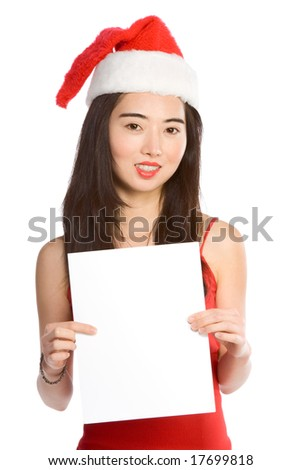 Mrs. Santa Claus template; Chinese woman holding blank sheet of white paper in front of her. This empty area may be used as copy space to put advertisement or announcement, or any other required text #17699818
