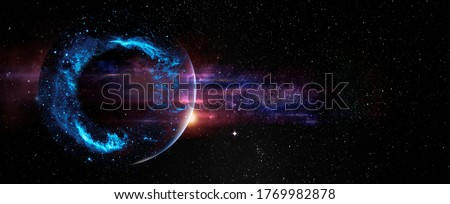 Black hole over star field in outer space, abstract space wallpaper with form of letter O and sparks of light with copy space. Elements of this image furnished by NASA. Royalty-Free Stock Photo #1769982878