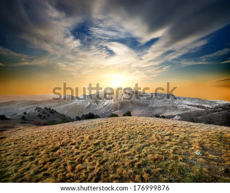 Autumn mountains and dry grass at sunset #176999876