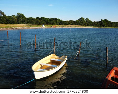 Typical traditional colorful small Danish fishing dingy boat in a harbour at Funen Denmark #1770224930