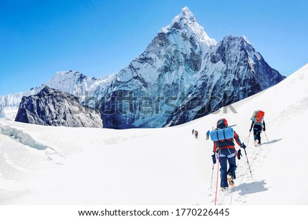Group of climbers reaching the Everest summit in Nepal.  #1770226445