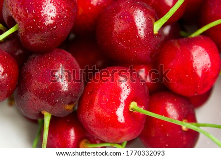 A lot of fresh sweet cherry fruit berries with water drops, close up. Pile of ripe cherries. Large collection of fresh red cherries. Ripe cherries texture background #1770332093