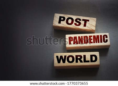 Wooden blocks with words Post-pandemic world. New normal social and business concept. Royalty-Free Stock Photo #1770373655