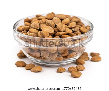Portion of Apricot Kernels isolated on white background as detailed close up shot (selective focus) Royalty-Free Stock Photo #1770657482