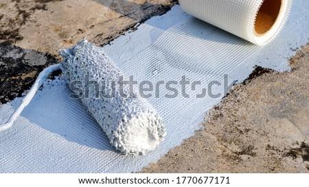 Hand painted gray flooring with paint rollers for waterproof, reinforcing net,Repairing waterproofing deck flooring. #1770677171