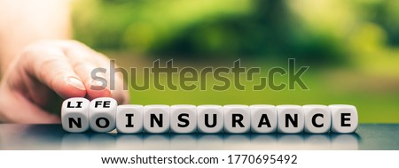 """Hand turns dice and changes the expression """"no insurance"""" to """"life insurance"""". Royalty-Free Stock Photo #1770695492"""