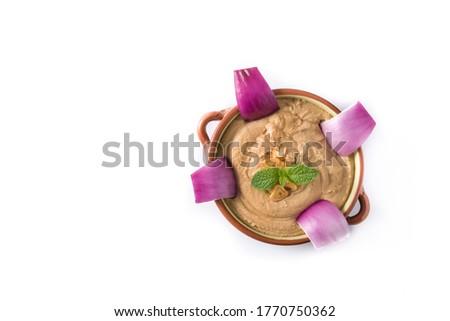 Gofio escaldado in bowl isolated on white background. Canarian food Royalty-Free Stock Photo #1770750362