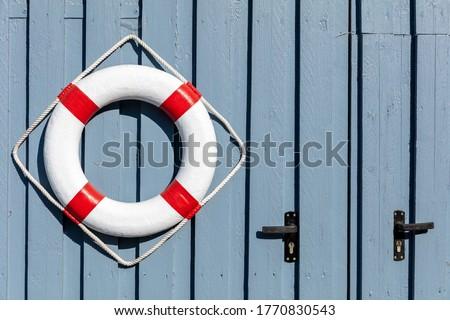 ring buoy at fishing lodge Royalty-Free Stock Photo #1770830543