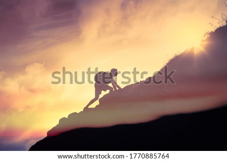 Man climbing up a mountain. Motivation, and inspiration concept.  #1770885764