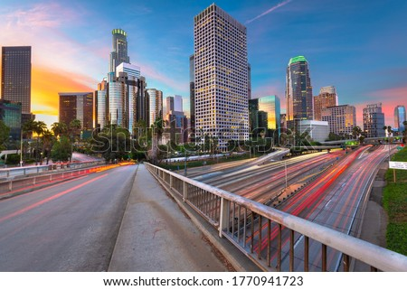 Los Angeles, California, USA downtown skyline and highways at twilight.