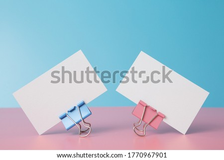 Business card on pink and blue background