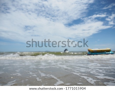 Picture blur, Jet ski boats and players float on the sea beside the beach.