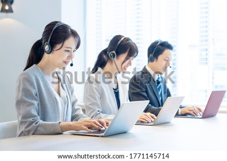 Group of asian operator. Call center. Customer support. Royalty-Free Stock Photo #1771145714