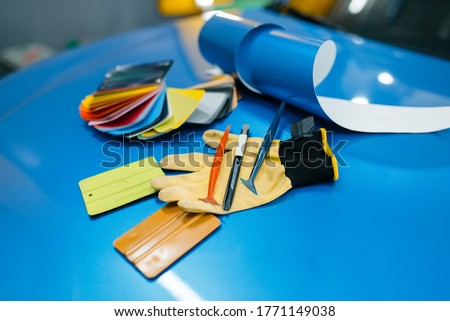 Car wrapping, color palette and installation tools Royalty-Free Stock Photo #1771149038